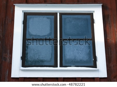 Old window in the cold winter