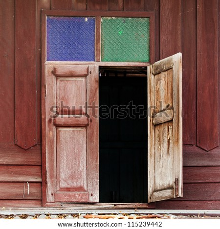 Old window in wooden cottage - stock photo