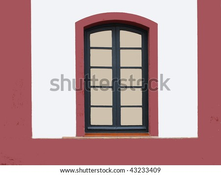 Old window on a white building