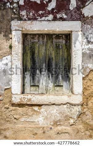 Old window on abandoned house