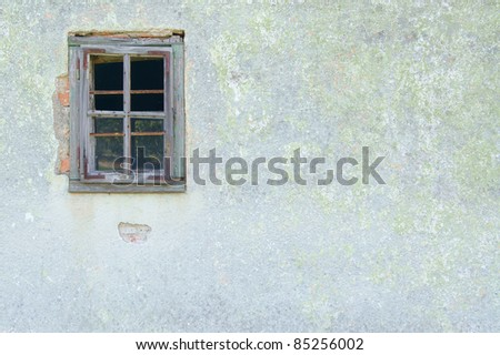 old window on the wall - stock photo