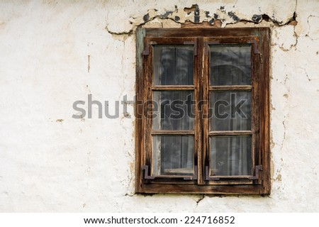 Old window on white wall - stock photo