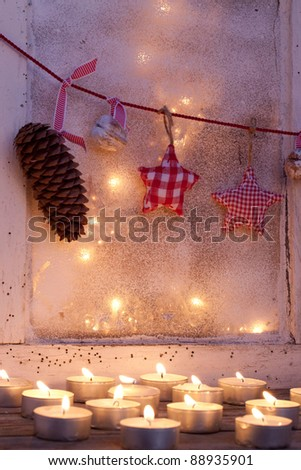 Old window with christmas decoration - stock photo