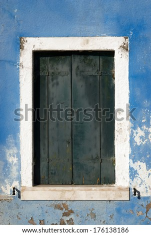 Old window with shutters - stock photo