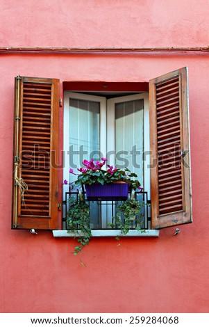 Old window shutters flowerpot stock photo royalty free 259284068 old window with shutters and flowerpot sisterspd