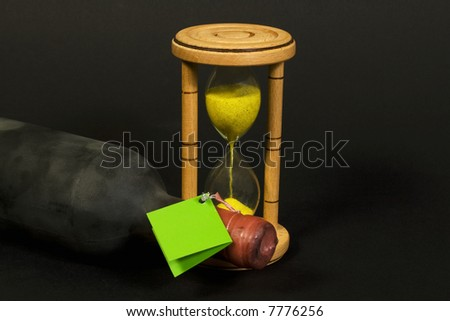 Old wine bottle detail with wood hour glass - stock photo