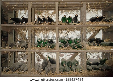 old wine bottles in a cellar - stock photo