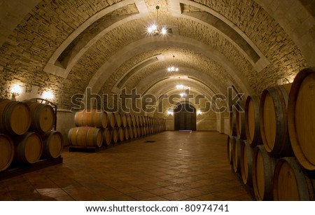 old wine cellar with barrels - stock photo