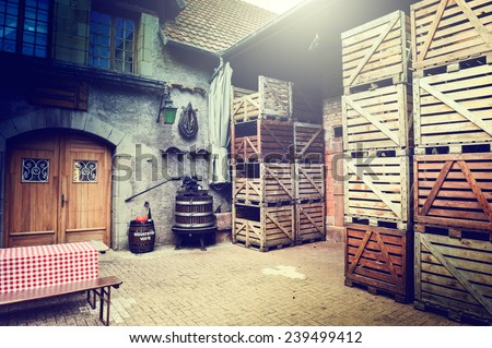 Old winery backyard with empty wooden crates - stock photo