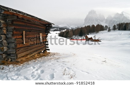 Old winter wood cottage in Dolomiti Alps, Ortisei, italy.