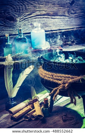 Old witch hut with blue potions, books and scrolls for Halloween