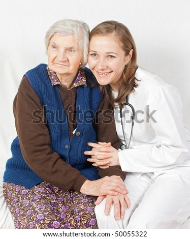 Old woman and the sweet young doctor - stock photo
