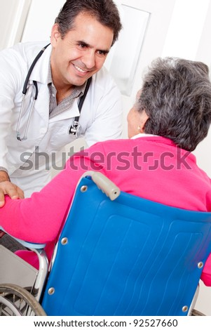 Old woman arriving to the hospital in a wheelchair - stock photo