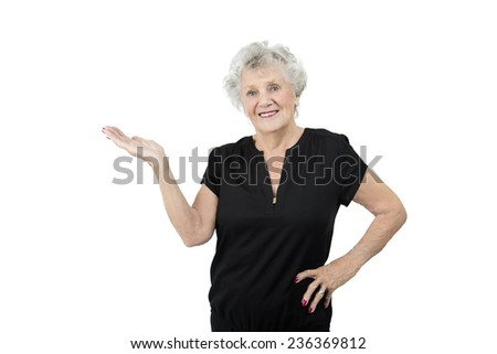 Old woman doing a gesture with her hand against a white background - stock photo