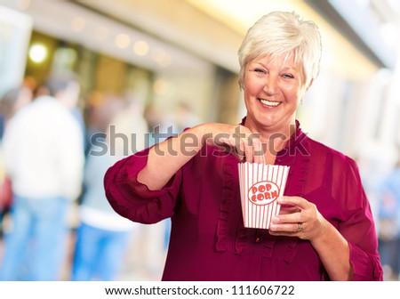 Old Woman Eat Popcorn, Outdoor - stock photo