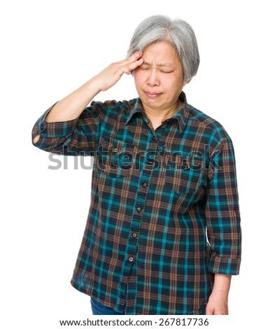 Old woman feel headache - stock photo