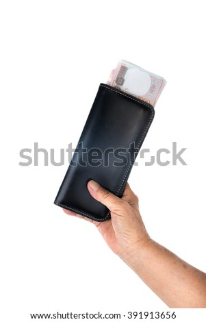 Old woman hand holding Thai money in long black wallet on white. - stock photo