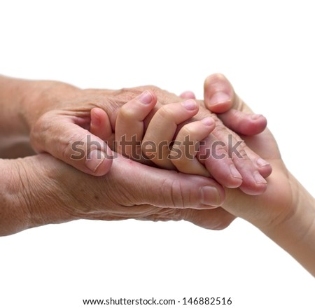 old woman hands holding the hand of a kid - stock photo