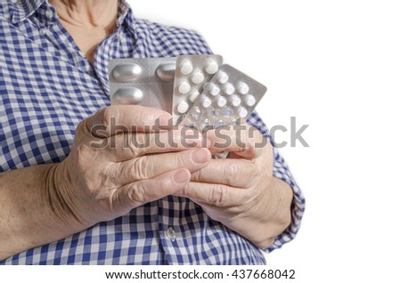 Old woman hands with pills isolated on white background. Conceptual image of health care for the elderly people. - stock photo