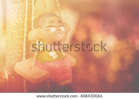 old woman happy swing doll in the park vintage color tone, Happy Life After Retirement  concept. - stock photo