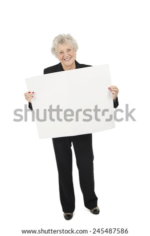 Old woman holding a blank billboard against a white background - stock photo