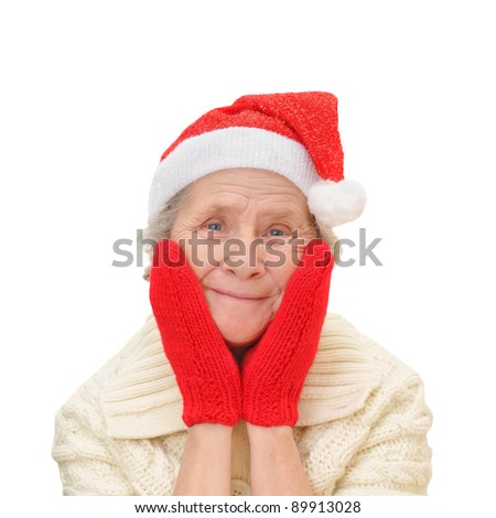 old woman in red Santa Claus hat and red mittens, isolated on white background - stock photo