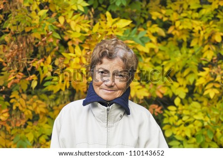 Old woman in the forest - stock photo