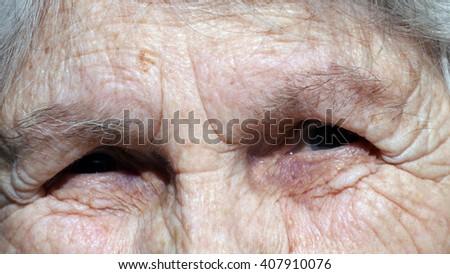 Old woman looking at camera and smiling. Closeup - stock photo