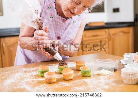 Woman Decorating Cupcakes woman cupcake stock images, royalty-free images & vectors