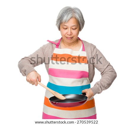 Old woman making food - stock photo