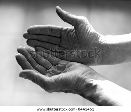 Old woman palm open up as a gesture of peace and giving thanks