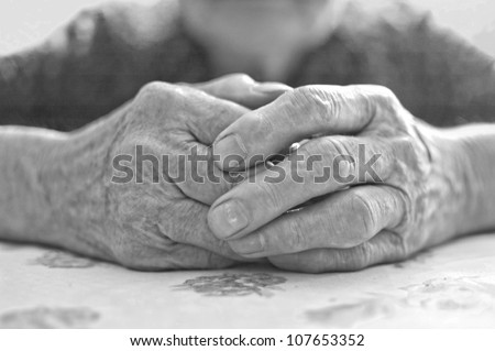 Old woman's hand - stock photo