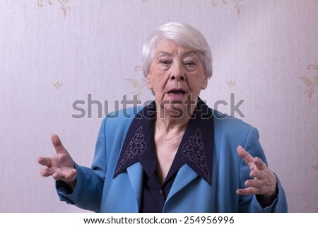Old woman shocked - stock photo