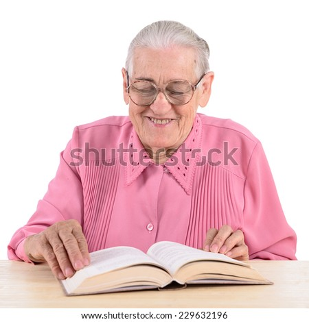 old woman sitting near table with book. portrait isolated on white background - stock photo