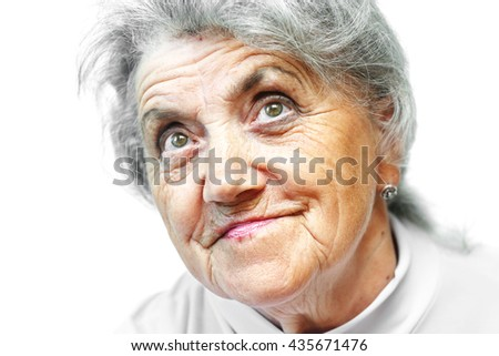 Old woman smile face on white - stock photo