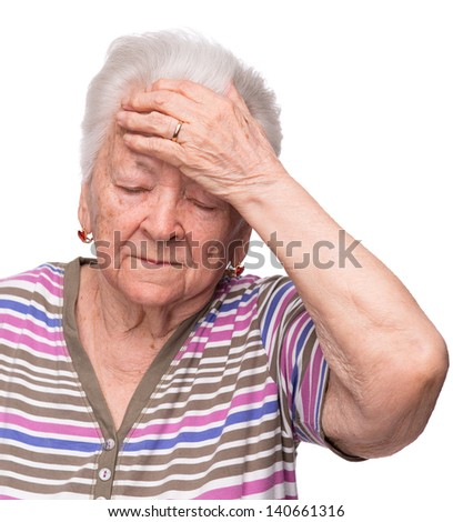 Old woman suffering from headache on white background