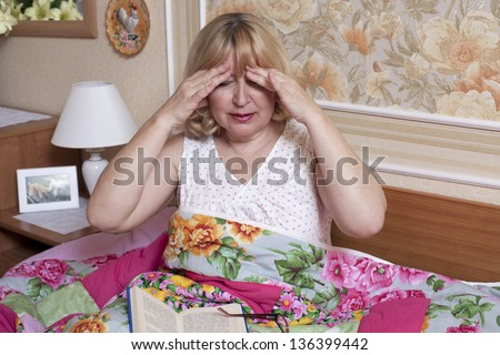 Old woman suffering with fever in the bedroom - stock photo
