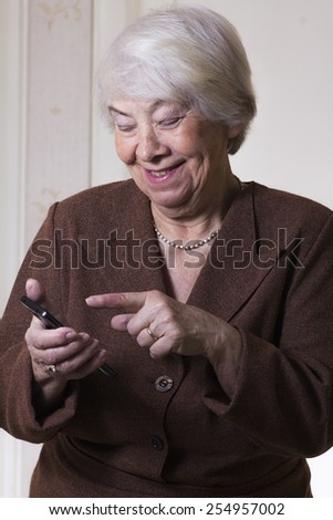 Old woman texting - stock photo
