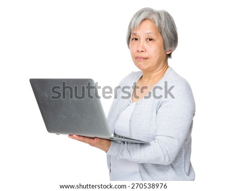 Old woman use of laptop - stock photo
