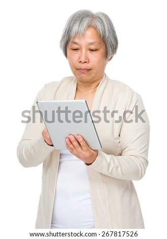 Old woman use of tablet - stock photo