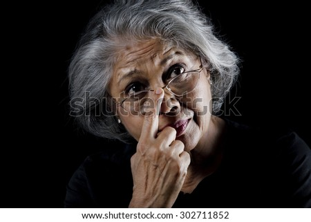 Old woman wearing glasses - stock photo