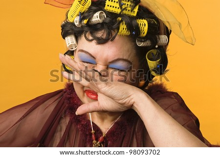 Old woman wipes her running nose - stock photo