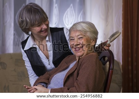 Old woman with a daughter. - stock photo