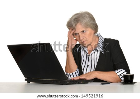 old woman with a laptop on a white background