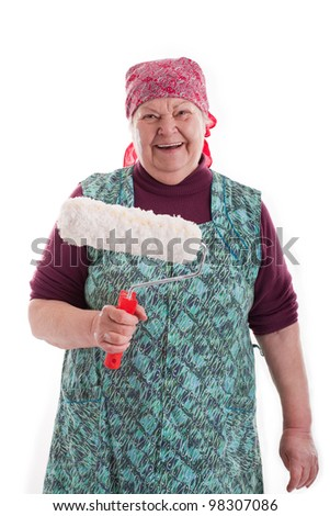 old woman with a paint roller - stock photo