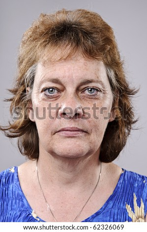 Old woman with deep wrinkles, must see full size - stock photo