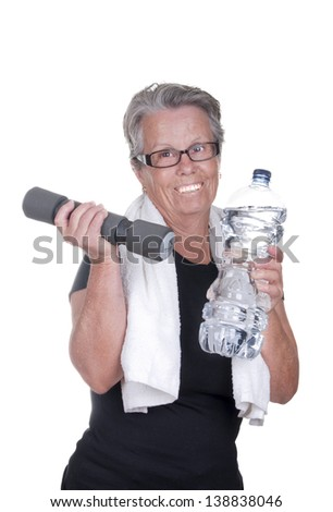 old woman with dumbbells and water bottle - stock photo