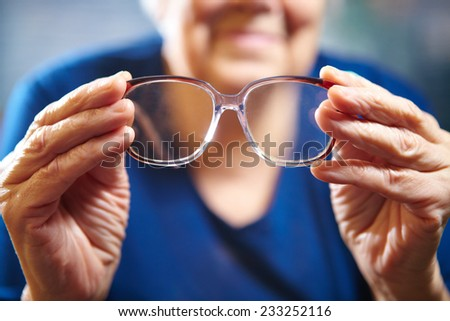 Old woman with eyeglasses. Senior people health care. - stock photo