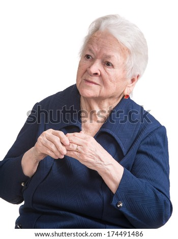 Old woman with painful fingers on a white background - stock photo