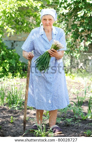 old woman working in the garden